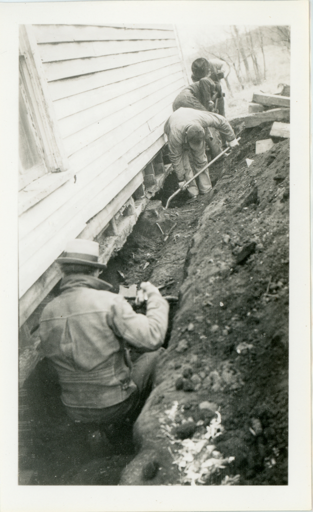 Four Men Working on Thomas Heminger Home