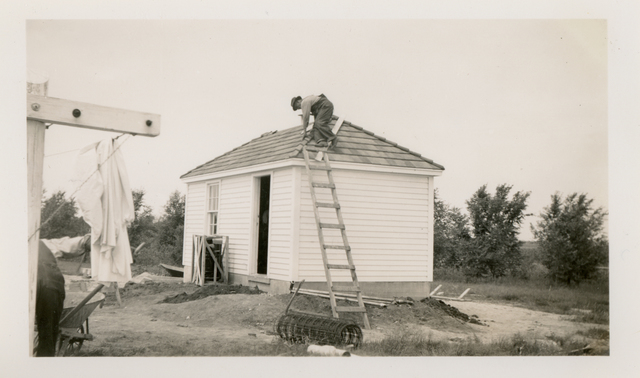 Laying Roof Tile on the Hospital Pump House