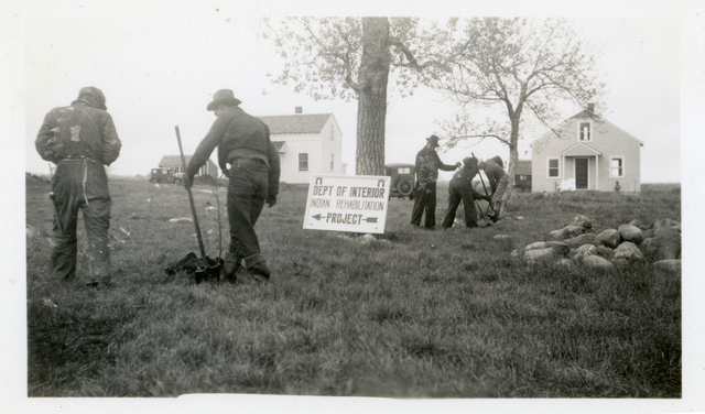 Men Planting Trees at Community Housing Project