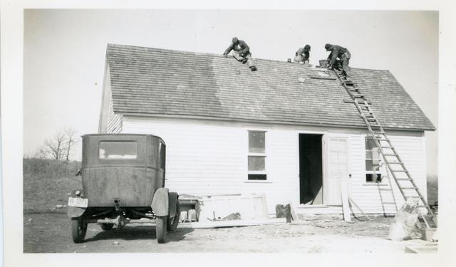 Three Men Repairing Roof on Angeline Robertson Home