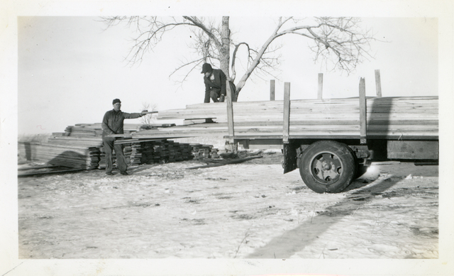 Unloading Lumber for Community Housing Project