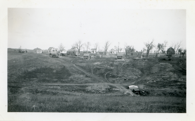 View of Stone House and Community Housing Project
