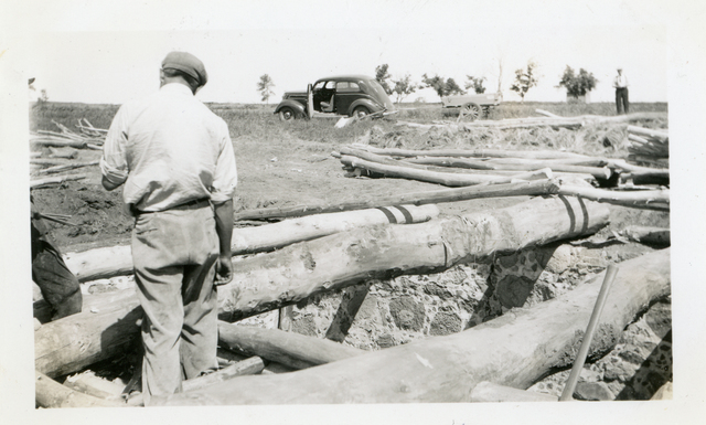 Worker Filling in Dirt at Agency Root Cellar