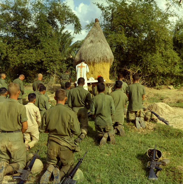 Photograph of Catholic Chaplain Captain Bruno Massoti Conducts Services for Troops during the Operation