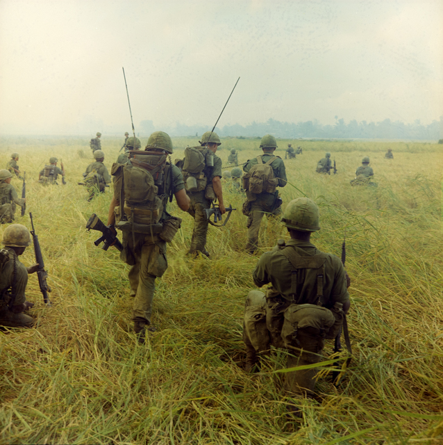 Photograph of Troops Moving across a Rice Field in Search of Viet Cong