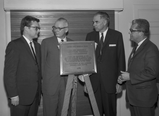 25th anniversary of the discovery of plutonium. Group, including Glenn Seaborg (second from right) with a plaque designating Room 307 of Gilman Hall a National Historic Landmark, taken February 21, 1966. Morgue 1966-12 (P-4) [Photographer: Donald Cooksey]