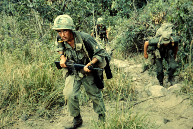 Photograph of Members of the Long Range Reconnaissance Team Moving through Rough Terrain Searching for Viet Cong near Tuy Hoa