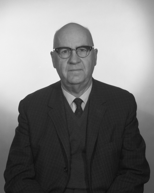 Passport photo of Wallace B. Reynolds, taken March 2, 1966. Morgue 1966-8 (P-1) [Photographer: Donald Cooksey]