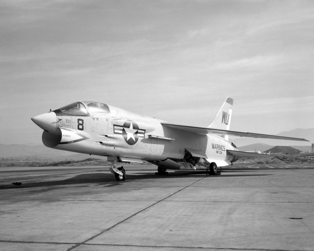 A left front view of an F-8C Crusader aircraft parked on the flight line. The aircraft is assigned to Marine Fighter Squadron 334 (VMF-334)