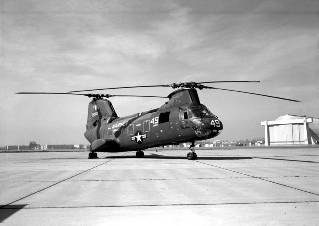 A right front view of a CH-46A helicopter from HMM-165 parked on the flight line