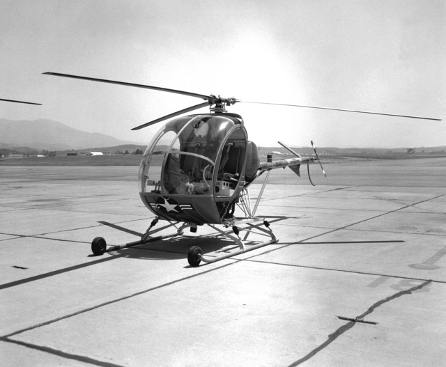 A left front view of a U.S. Army TH-55A Osage helicopter parked on the flight line