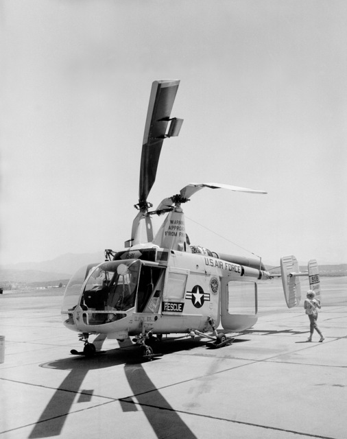 A left front view of a US Air Force HH-43B Huskie helicopter parked on the flight line