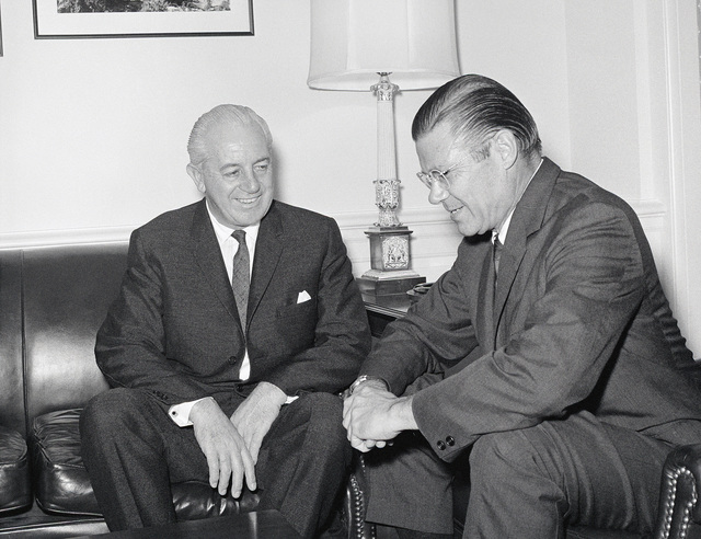 Secretary of Defense Robert S. McNamara, right, meets at the Pentagon with Harold E. Holt, prime minister of Australia