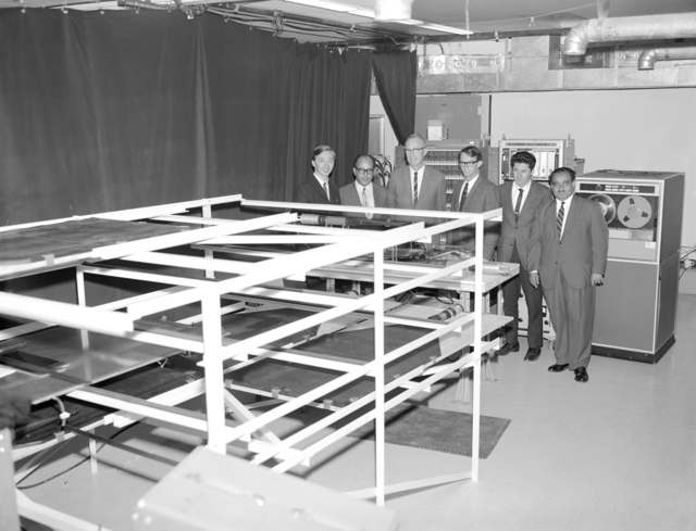 Spark chambers for Egyptian pyramid x-ray project near completion and ready for installation in Chephren's pyramid. Egyptian scientists F. El Bedewi and Ahmed Fakhry, who are co-directors of the project along with Lawrence Radiation Laboratory's Luis Alvarez, inspected the apparatus during a recent visit to the Hill. Shown are (left to right) Jerry Anderson, Dr. El Bedewi, Luis Alvarez, James Burkhard, Lauren Yazalino and Dr. Fakhry. Morgue 1966-95 (P-5). [Photographer: Donald Cooksey]