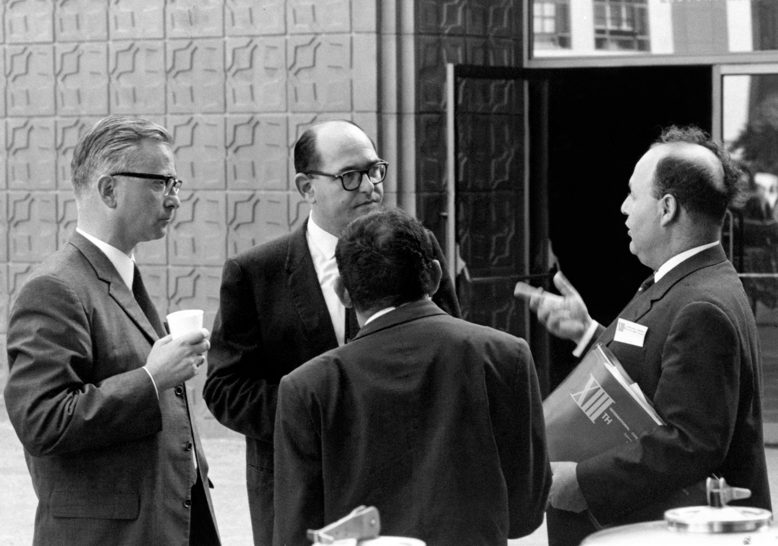 Lawrence Radiation Laboratory hosts the High Energy Physics Meeting. Clockwise from left Klaus Bottstein of the Max Planck Institute, Munich; Gerson Goldhaber, LRL; Gideon Alexander and Gideon Yekutieli, both of the Weizmann Institute of Science, Isreal. Photo taken September 1966. Morgue 1966-150 [Photographer: Donald Cooksey]