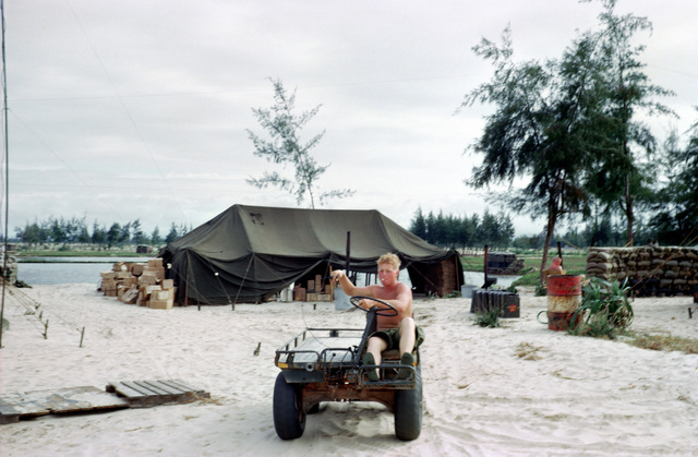 "A Marine operates an M274 utility platform truck in the bulk fuel area at Cua Viet. The M274 is commonly referred to as a ""mechanical mule."""