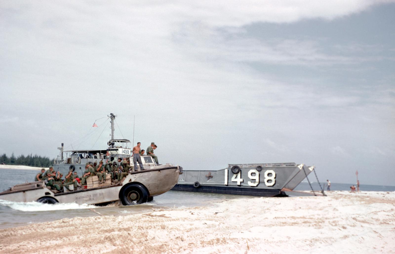 https://cdn10.picryl.com/photo/1966/10/01/a-starboard-bow-view-of-utility-landing-craft-1498-lcu-1498-beached-at-cua-5b77bc-1600.jpg