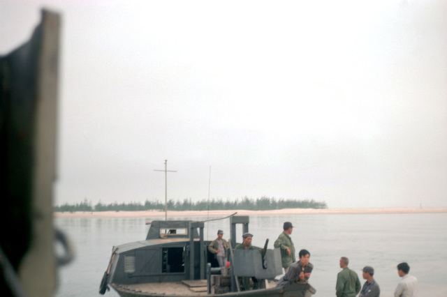 A Vietnamese navy patrol boat visits the Cua Viet facility. A machine gun is mounted on the bow of the boat