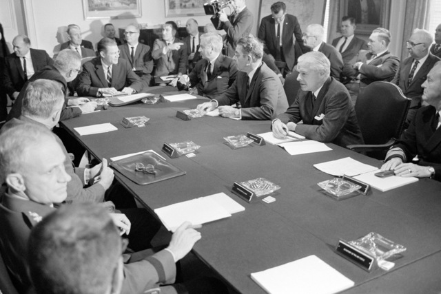 Secretary of Defense Robert S. McNamara, at the far end of the table, meets with officials of the General Electric Company and the International Union of Electrical Radio and Machine Workers at the Pentagon to discuss action to be taken to avert a nationwide strike