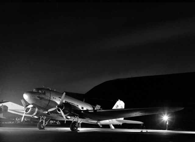A fully-loaded C-47 Skytrain aircraft is poised on the flight line prior to takeoff on a night flare drop mission. Members of the Vietnamese air force (VNAF), 33rd Tactical Wing, work side by side with U.S. Air Force Advisory Team-1 (AFAT) personnel to provide flarelight for allied ground security forces and Air Force air-to-ground tactical air support operations