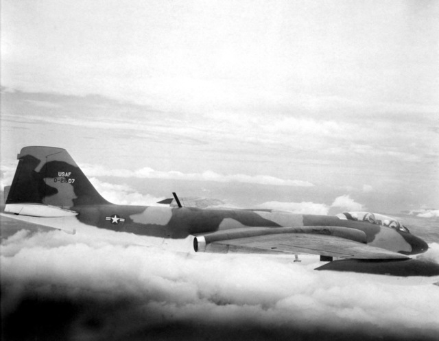 AN air-to-air right side view of a B-57 Canberra aircraft heading for a strike mission, ending the two-month tour of the 13th Tactical Bombardment Squadron in Vietnam from Clark Air Base, Philippines. The maintenance crew of the 13th Tactical Bombardment Squadron recently established a unit maintenance record of 12,000 combat missions flown without a single ground cancellation