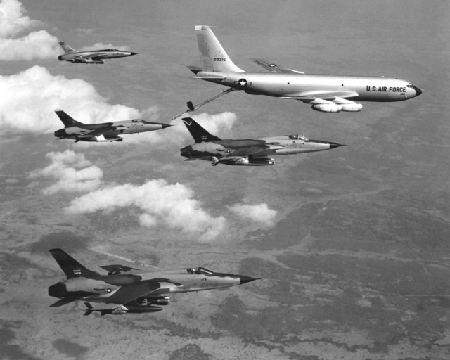 F-105D Thunderchief aircraft are refueled on their way to North Vietnam targets by a KC-135 Stratotanker aircraft. The Thunderchiefs are being used to check the flow of North Vietnamese supplies and troops into the south. They interdict supply routes and destroy trucks and rolling stock
