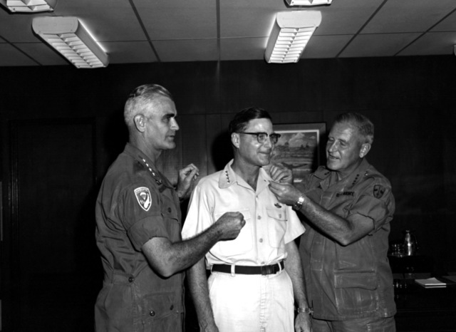 LGEN William W. Momyer receives his fourth star from GEN William C. Westmoreland, left, and GEN Creighton W. Abrams, right, commander, and deputy commander, U.S. Forces, Vietnam. Momyer, deputy commander, air operations, U.S. Military Assistance Command, Vietnam (MACV), and commander, 7th Air Force, was nominated for the rank by President Lyndon B. Johnson