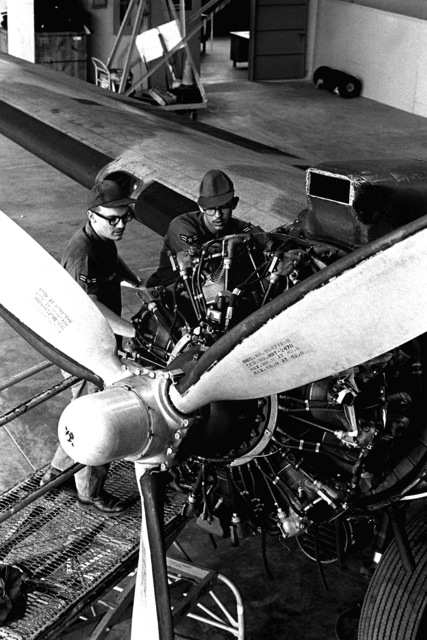 Maintaining and repairing delicate flight instruments in the engines of a combat aircraft is the work of A1C Kenneth W. Trossn, left, and George C. Wolf. Both airmen are instrument repairman specialists from the 17th Air Commando Wing