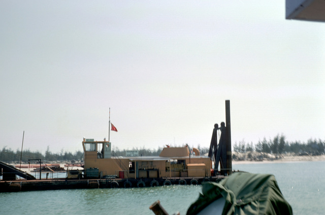 """The Canadian dredge """"Helbar"""" dredges out a portion of the Cua Viet River during the construction of an LST landing ramp at Cua Viet. The ramp is being built by the RMK Construction Co. with assistance from Mobile Construction Battalion 5 (MCB-5)"""