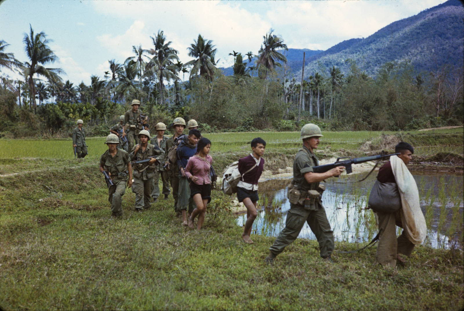 "Photograph of Members of Company ""A"" Return to Base Camp with Viet Cong Prisoners during Operation Thayer II"