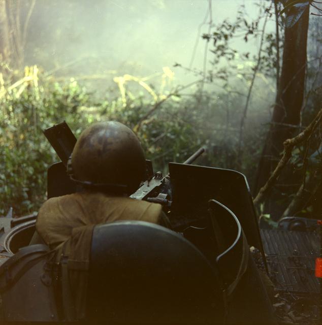 Photograph of Staff Sergeant Harry F. Mitchell Firing a 50 Caliber Machine Gun during Operation Junction City