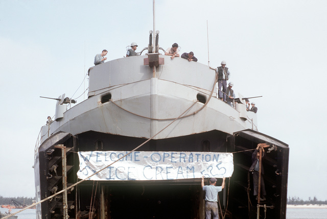 A port bow view of the tank landing ship USS CAROLINE COUNTY (LST-525) with its bow doors open while docked at Cua Viet. The ship brought ice cream to the Marines at Cua Viet to commemorate its visit, the first by an LST