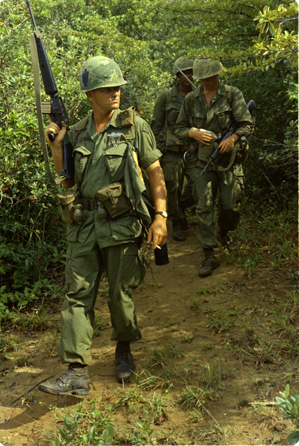 Photograph of Private James E. Stadig and Other Members of His Company Come out of a Viet Cong Cave