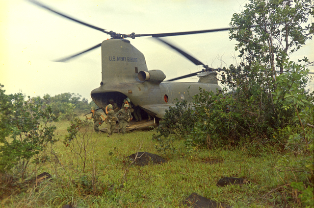 Photograph of Soldiers Unloading from a Ch-47A Chinook Helicopter