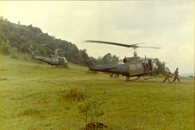 Photograph of Soldiers Unloading from UH-1D Helicopters