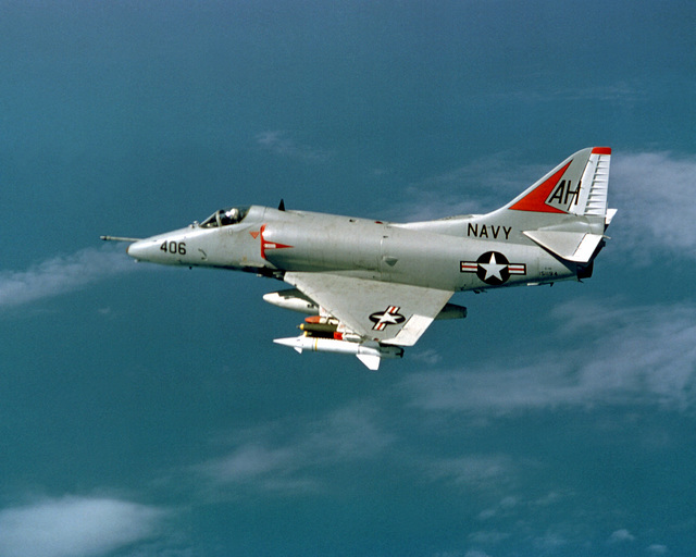 An air-to-air left side view of an Attack Squadron 164 (VA-164) A-4 Skyhawk aircraft en route to a target in North Vietnam. The aircraft is piloted by CMDR. William F. Span, executive officer of VA-164