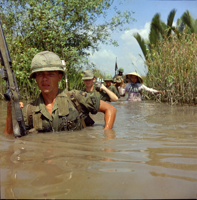 Photograph of Private Fred L. Greenleaf Crossing a Deep Irrigation Canal during Operation Bang Dong