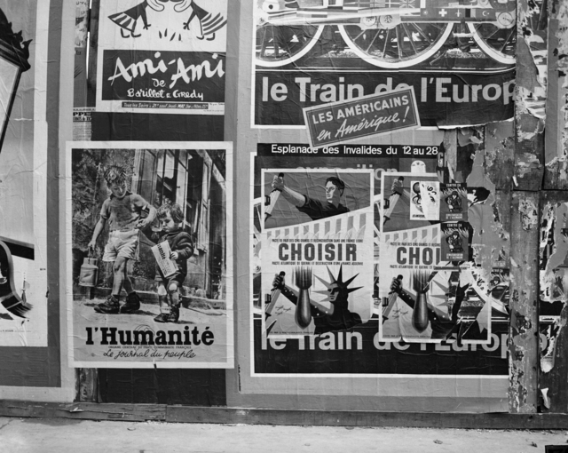 [Paris Wages War of Posters (Communist Posters pasted over the M.P. Poster)]