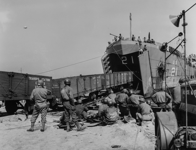 Photograph of a String of Railroad Cars Loaded with Vital War Supplies in England and Delivered in France