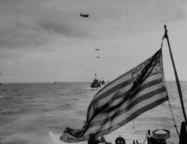 Photograph of Columns of Coast Guard LCIs Advancing upon the Beaches of France in the Wake of the Stars and Stripes