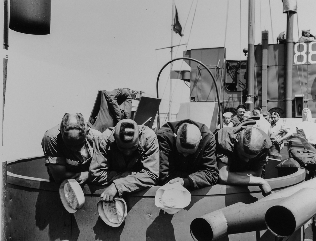 Photograph of Four Coast Guardsmen Serving as Scouts and Proceeding in an LCM to the French Invasion Beach