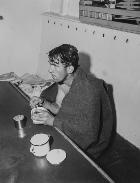Photograph of Private William Bonneville Wrapped in a Blanket after an Exhausting Struggle with the Chill Currents of the English Channel