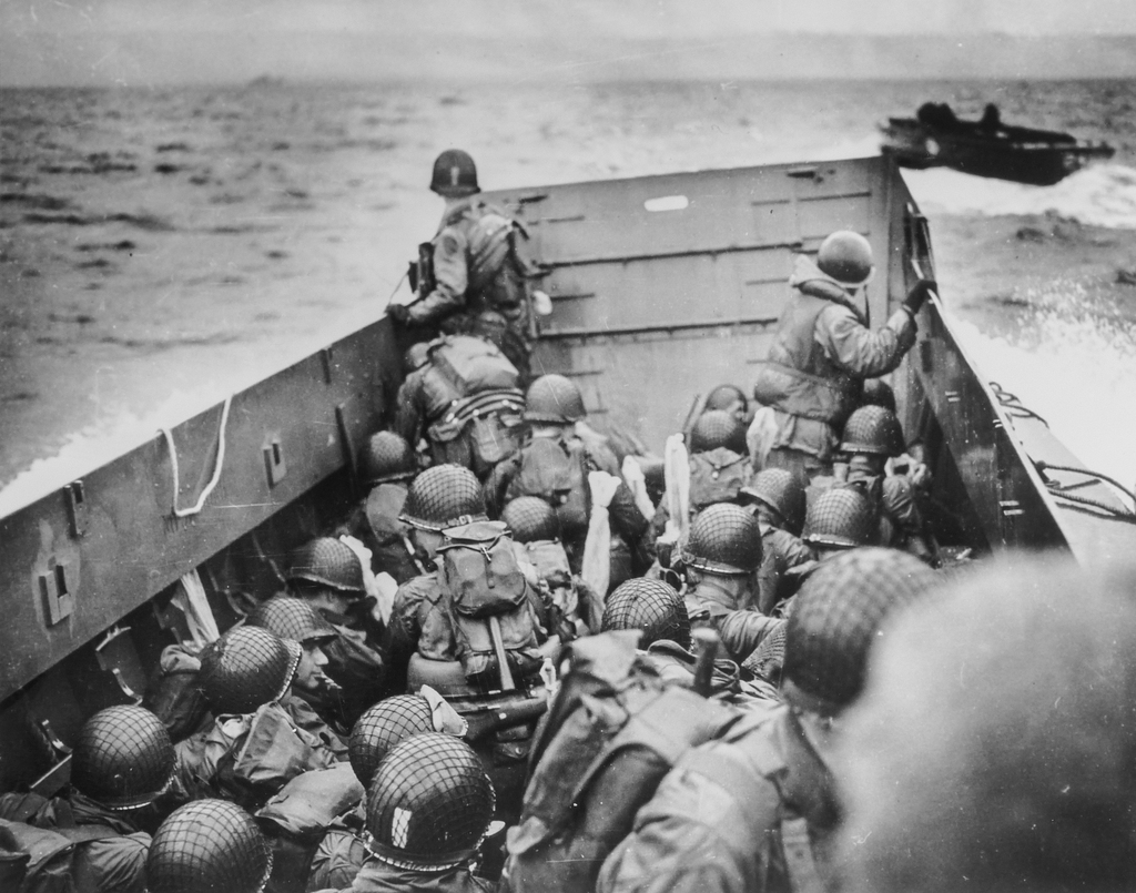 Photograph of Soldiers Crouching Behind the Bulwarks of a Coast Guard Landing Barge