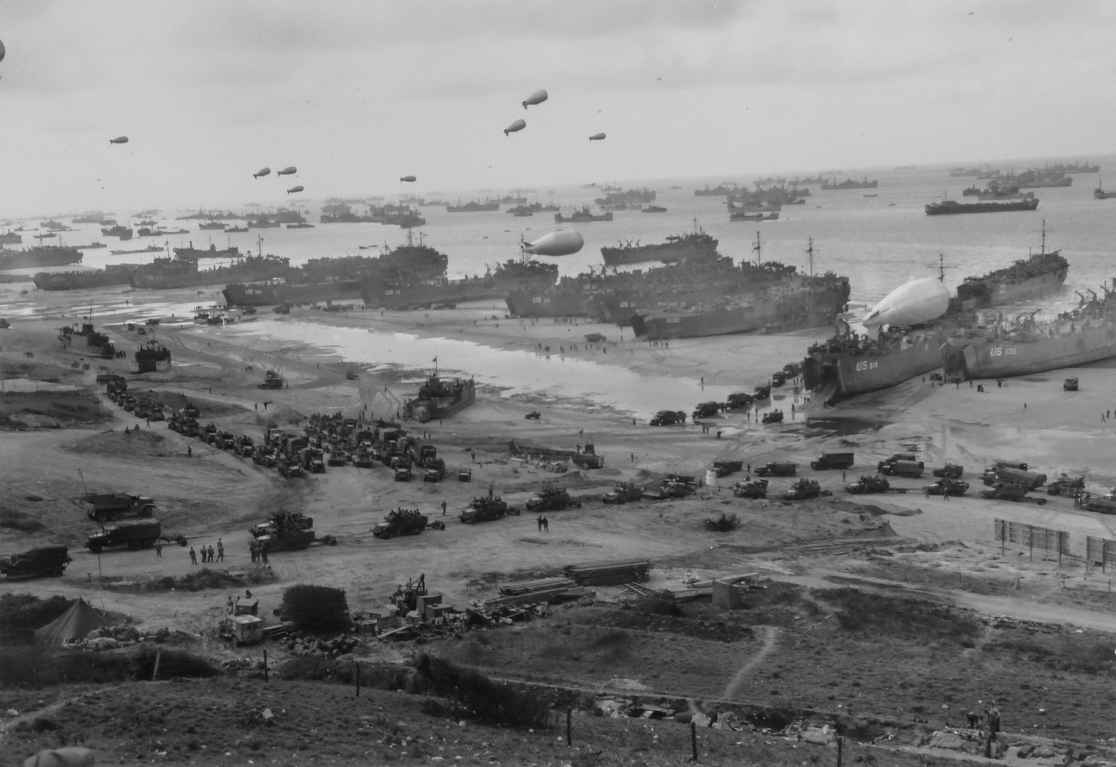 Photograph of the French Invasion Beach Made by a Coast Guard Combat Photographer from a Hillside Cut with the Trenches of the Ousted Nazi Defenders