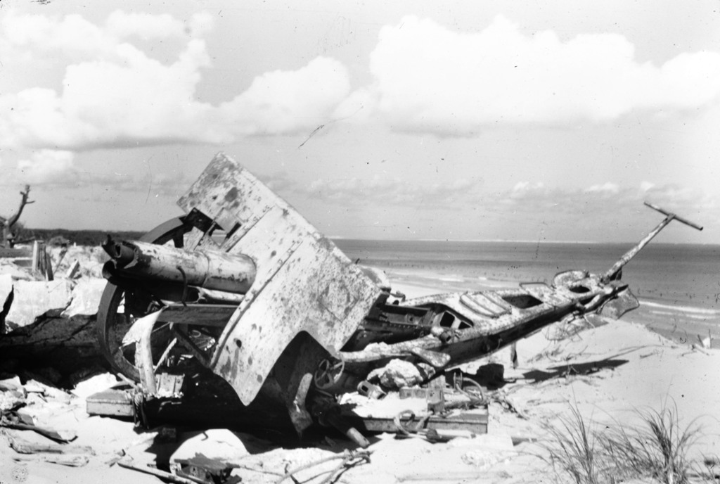 [War Wrecks Litter Normandy Beach]