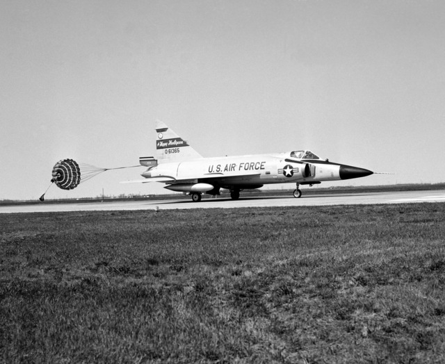 """A U.S. Air Force F-102 Delta Dagger aircraft assigned to the 119th Fighter Wing""""Happy Hooligans"""", 178th Fighter Squadron, North Dakota Air National Guard, deploys its drag chute after landing on the runway at Hector International Field, North Dakota. (A3604) (U.S. Air Force PHOTO) (Released)"""