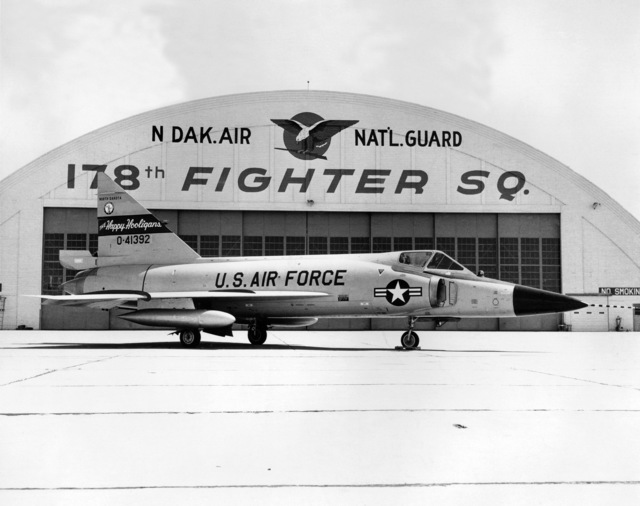 """A U.S. Air Force F-102 Delta Dagger aircraft assigned to the 119th Fighter Wing""""Happy Hooligans"""", 178th Fighter Squadron, North Dakota Air National Guard, sits parked in front of an aircraft hangar at Hector International Field, North Dakota. (A3604) (U.S. Air Force PHOTO) (Released)"""