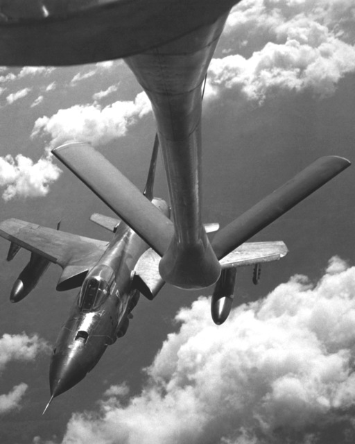 "AN air-to-air front view of an F-105D Thunderchief aircraft approaching a KC-135 Stratotanker aircraft for refueling during flight. Aerial refueling and forward air control crews were honored by 388th Tactical Fighter Wing F-105D Thunderchief aircraft pilots in recognition of their successful coordinated combat mission. The day of the combat was called ""Tanks a Million-That's a FAC"" day"