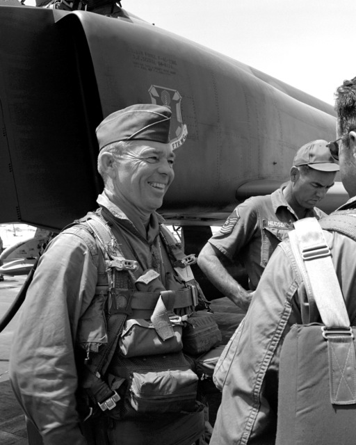 COL W. E. Davis Jr., commander, 12th Tactical Fighter Wing, talks with other pilots after completing his 200th and last combat mission over North and South Vietnam. The mission consisted of attacking a Viet Cong concentration area, destroying military fortifications and inflicting heavy damage