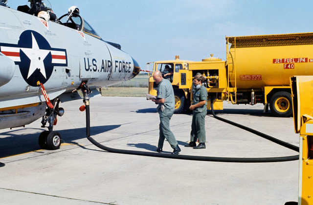 "U.S. Air Force Fuel SPECIALIST assigned to the 119th Fighter Wing""Happy Hooligans"", North Dakota Air National Guard, refuel a F-102 Delta Dagger aircraft on the flight line at Hector International Field, North Dakota. (A3604) (U.S. Air Force PHOTO) (Released)"